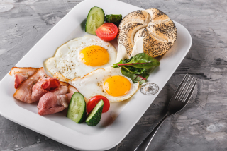Aried eggs with bacon and vegetables