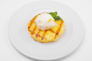 Grilled pineapple  with ice cream and ginger sauce