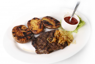 Moldavian style Steak with potatoes on the grill
