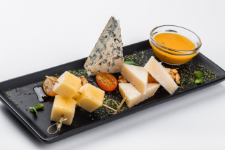 Assorted cheese with sea-buckthorn puree