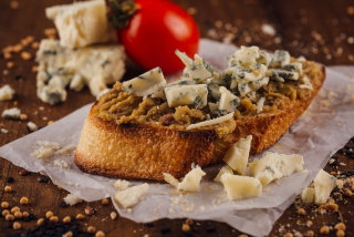 Bruschetta with olives and Dor blue