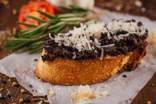 Bruschetta with olives and parmigiano