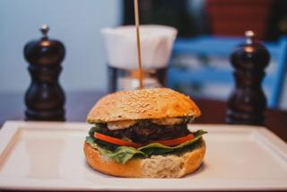 Burger with pesto sauce