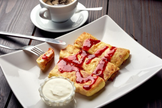 Crepe(thin pancakes) with sweet cottage cheese and raisins
