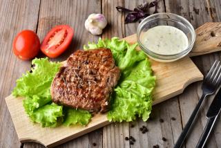 Beef steak with sauce cacık