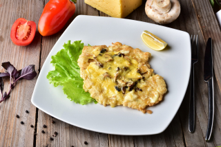 Pike perch with mayonnaise, mushrooms and cheese