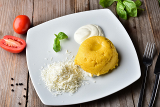Mamaliga with sheep cheese, sour cream and butter