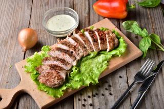 Cut pork tenderloin with sauce cacık