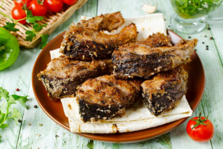 Carp fried with mujdei
