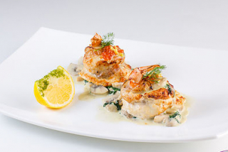 Fillet with shrimp and spinach sauce white fish