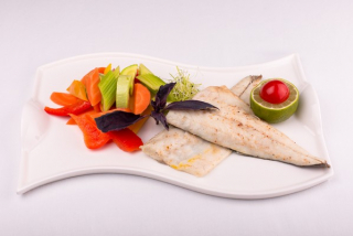 Fillet of sea bass with vegetables saute