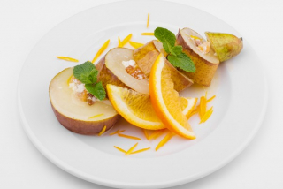 Baked pear with cottage cheese topping and dried fruits