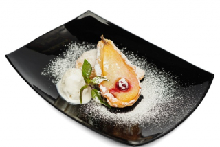 Pear baked in pasty with ice-cream