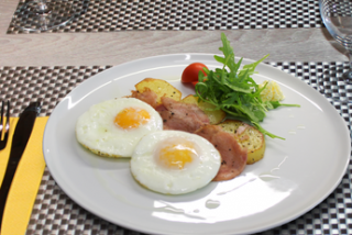 Eggs with potatoes and ham