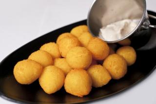 Potato bals with sauce