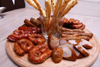 Assorted hot sausages to beer