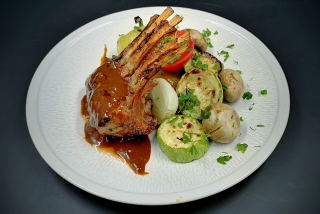 Rack of veal with demi-glace sauce and grilled vegetables