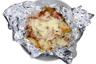Baked potatoes with bacon and cheese