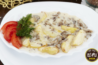 Baked potato with mushrooms in sauce Bechamel