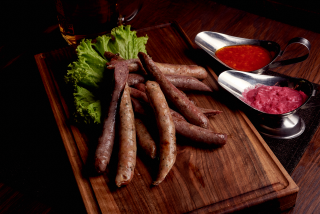Traditional sausages with sauce