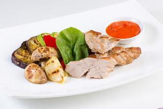 Pigtail pork tenderloin with grilled vegetables
