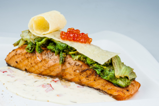 Salmon in cream sauce with grilled lettuce