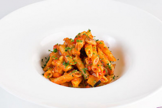 Pasta with sauce and vegetables Pilati