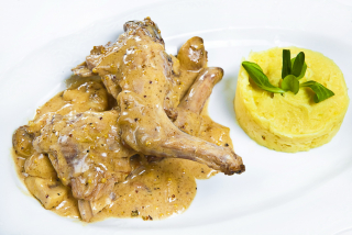 Rabbit meat with cream and mushrooms souce and mashed potatoes