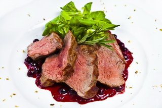 Beef meat with berry souce