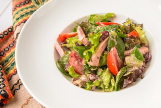 Salad with smoked meat, white mushrooms and red beans