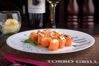 Roll of salted salmon with Philadelphia cheese