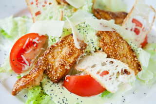 Caesar salad with wasabi sauce and chicken