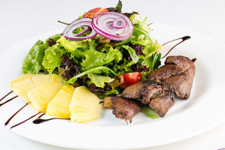 Salad with chicken liver and pineapple