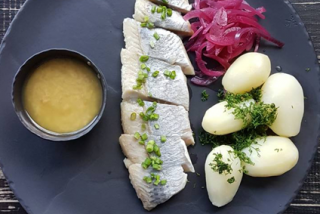 Herring with mousse of ginger, red onion and baked potatoes