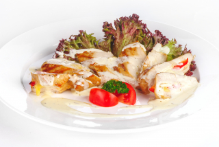 Stuffed chicken fillet with sauce