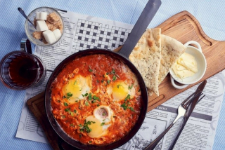 Shakshuk (a Jewish breakfast of three eggs and stewed tomato)
