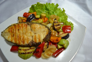 Salmon with vegetables on the grill