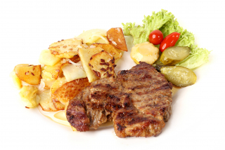 Steak of pork neck with potatoes at home