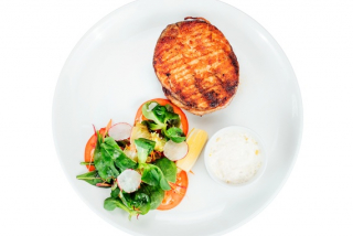 Grilled salmon steak in wheat crust and grilled avocado