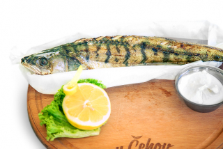 Pikeperch baked with tomatoes and lemon
