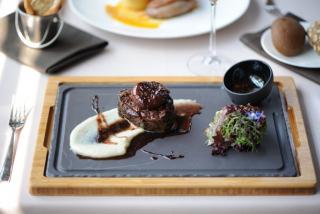 Tenderloin steak with spiced butter, Demi-Glace sauce & baked potatoes