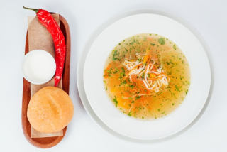 Traditional chicken zeama (soup) with homemade noodles