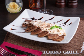 Tongue grilled with roasted garlic cream sauce